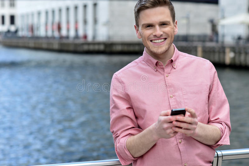 Casual pose of smiling man at outdoors stock photo