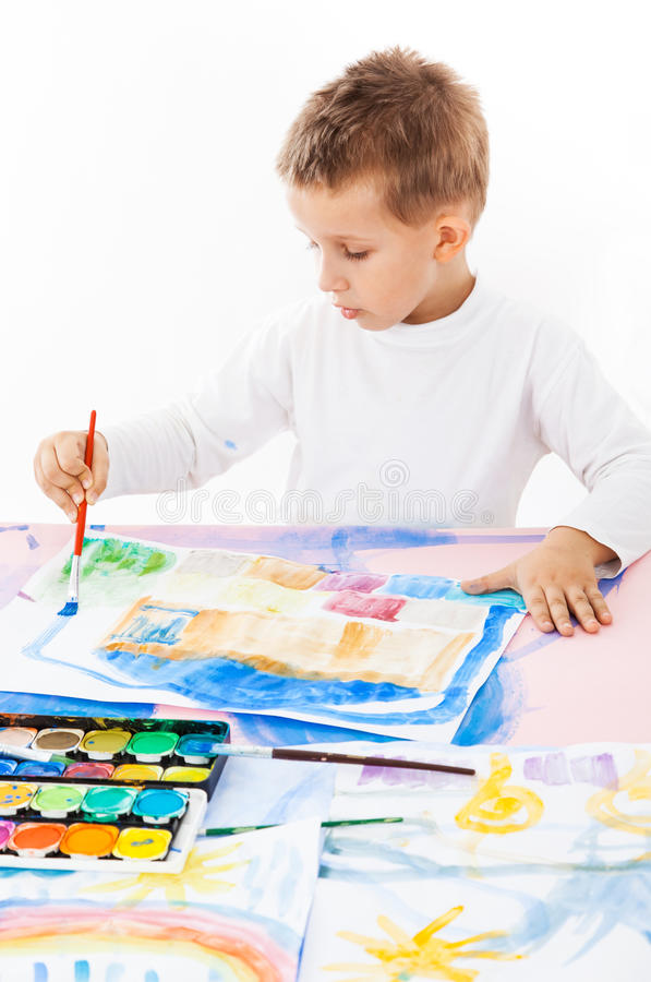 Casual schoolboy painting royalty free stock images