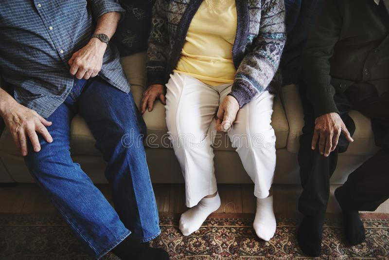 Casual senior adults sitting together stock photos