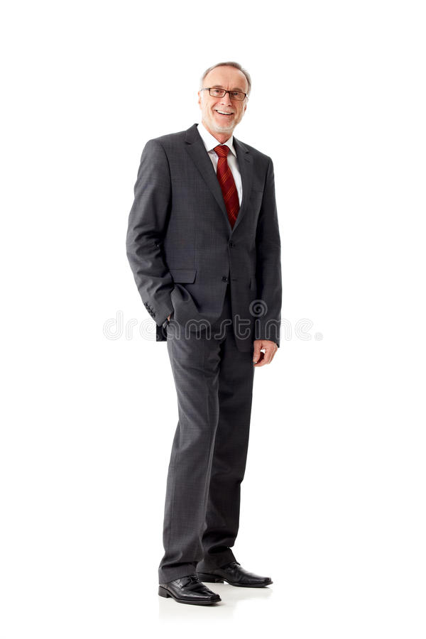 Casual senior business man standing on white background royalty free stock image
