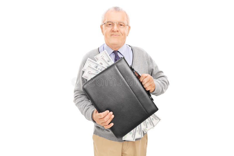 Casual senior holding a briefcase full of cash royalty free stock photo