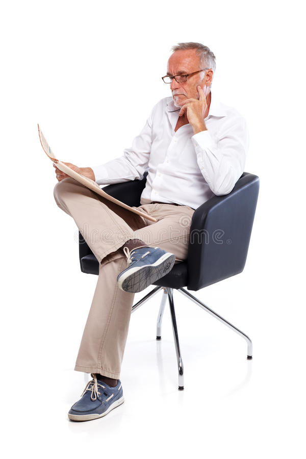 Casual senior man reading stock rates in newspaper 2 royalty free stock images