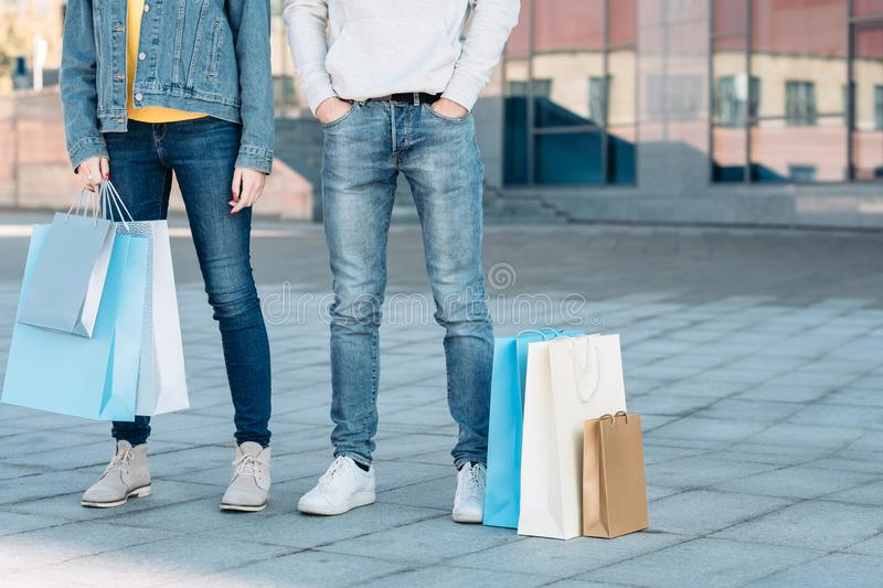 Casual shopping couple sale consumerism legs jeans stock images