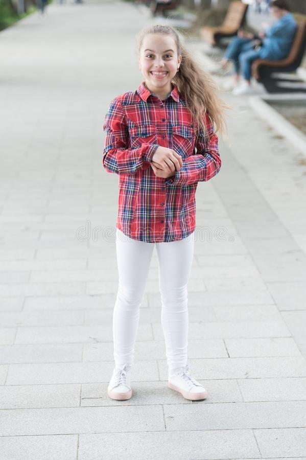 Casual silhouette with a relaxed fit. Happy small girl wearing casual and plaid shirt. Casual look of smiling little. Child. Adorable kid dressed for a casual stock image