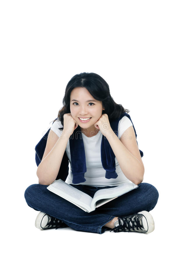 Download Casual Student Sitting On Floor With A Book Stock Photo - Image: 14103866