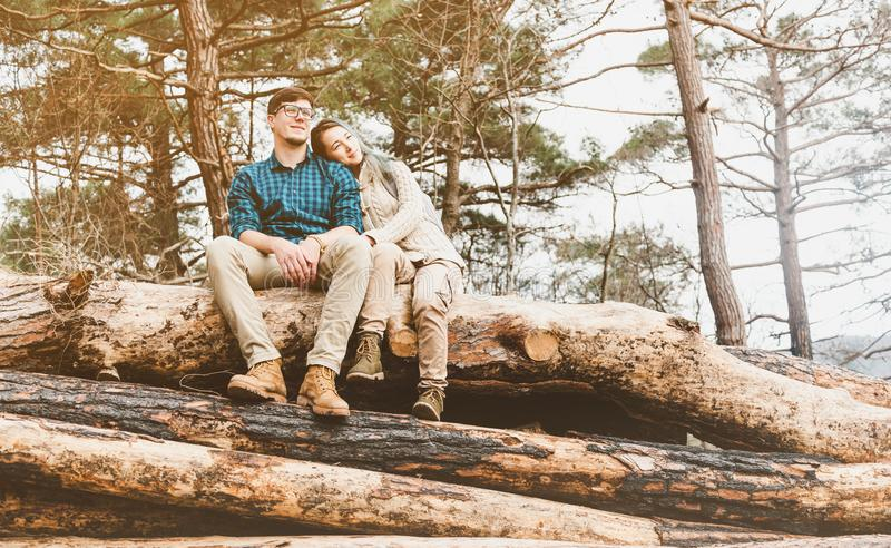 Couple resting on tree trunks. stock images
