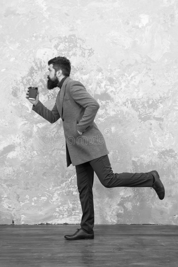 Casual style. Modern life. trendy man with beard. Brutal bearded hipster in denim wear. Male fashion model. Mature. Businessman drink take away coffee. Hurrying stock photo