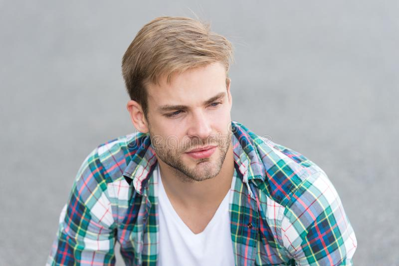 Casual style. student relax on road. macho guy outdoor. street style. man sit ground. carefree student guy. free time stock photos