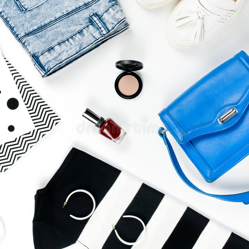 Casual style woman clothes and fashion accessories flat lay. Trendy patterns and prints concept. royalty free stock images