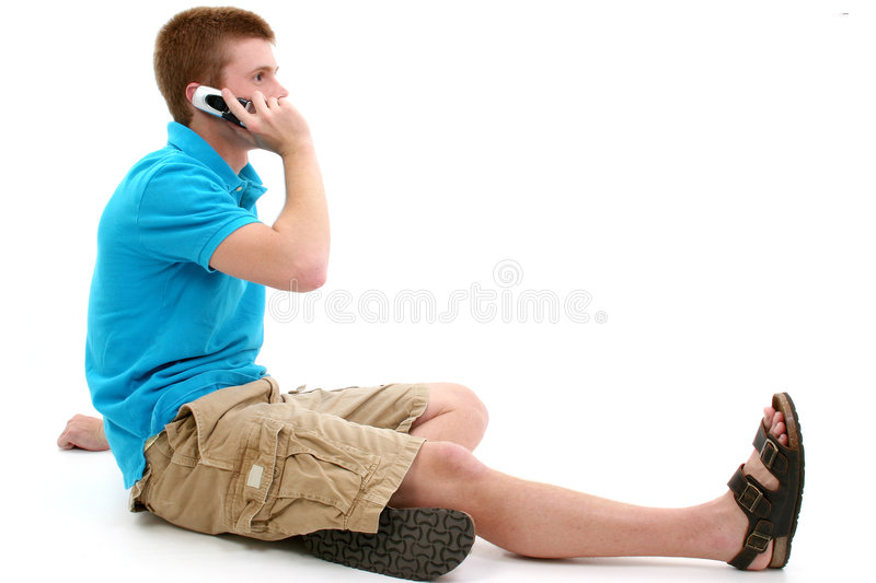 Casual Teen Speaking on Cellphone royalty free stock images