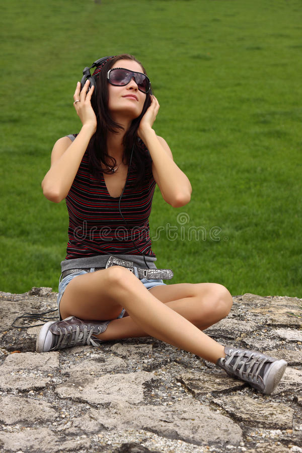 Casual teenager enjoy the music royalty free stock image
