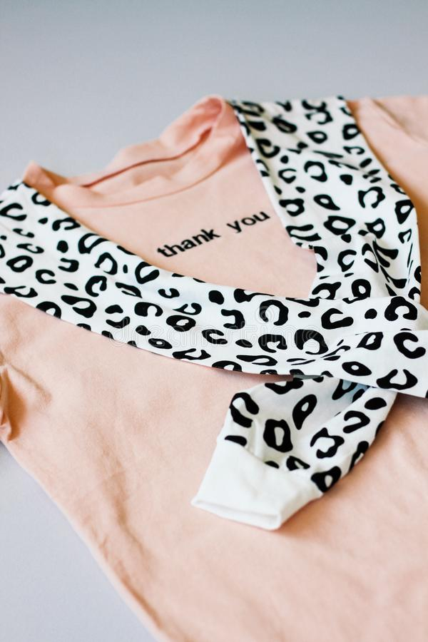 Casual and trendy clothes, coral-colored T-shirt and leopard sweatshirt. Isolated background. Trends 2019 year. stock photography