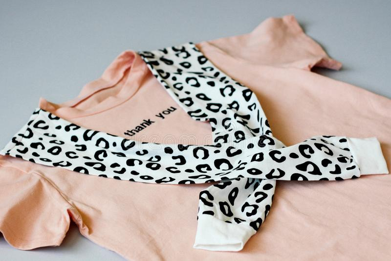 Casual and trendy clothes, coral-colored T-shirt and leopard sweatshirt. Trends 2019 year. Thank you. royalty free stock photo