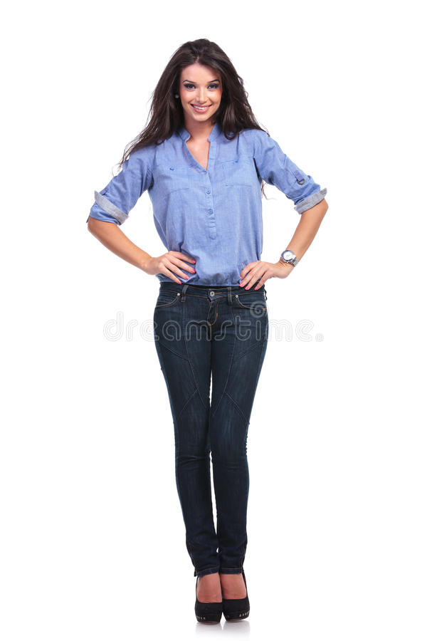 Casual woman with both hands on hips stock image