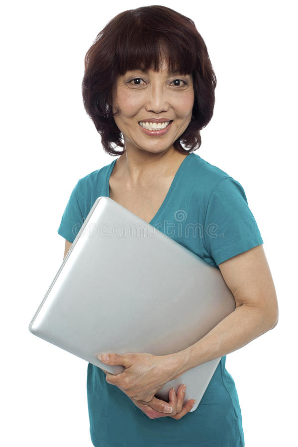 Download Casual Woman Carrying Her Laptop Stock Image - Image of confident, laptop: 26509597