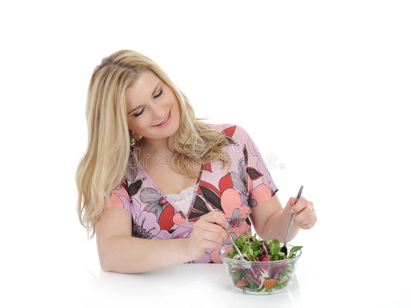 Download Casual Woman Eating Healthy Green Vegetable Salad Stock Photos - Image: 19131463