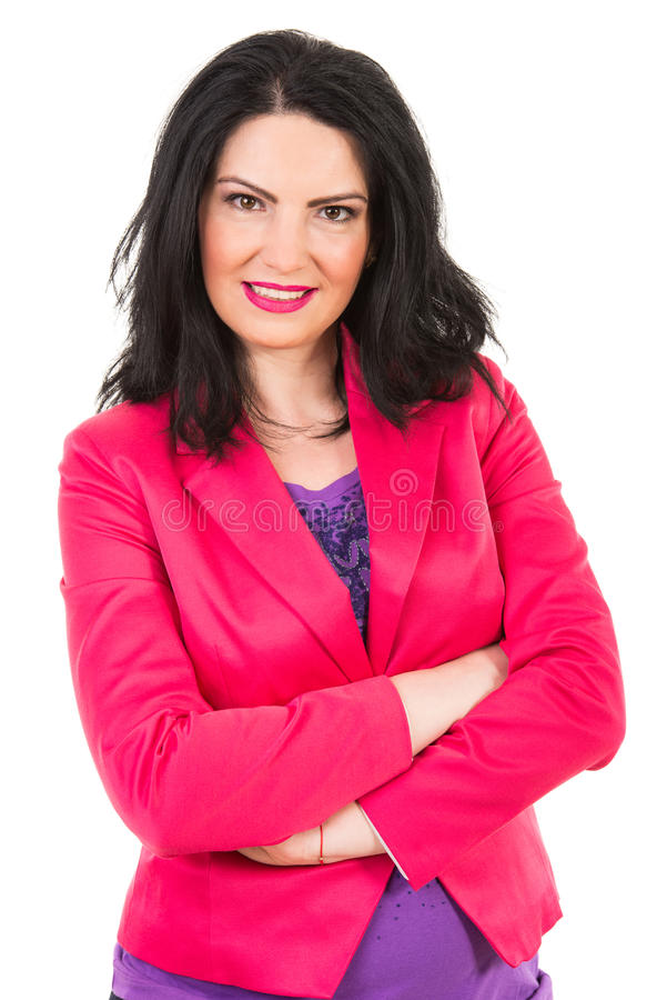 Casual woman in fuchsia jacket. Standing with arms folded isolated on white background stock images