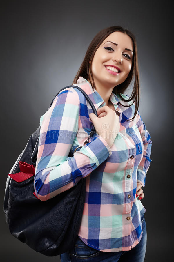 Casual Woman Holding A Bag Royalty Free Stock Photography