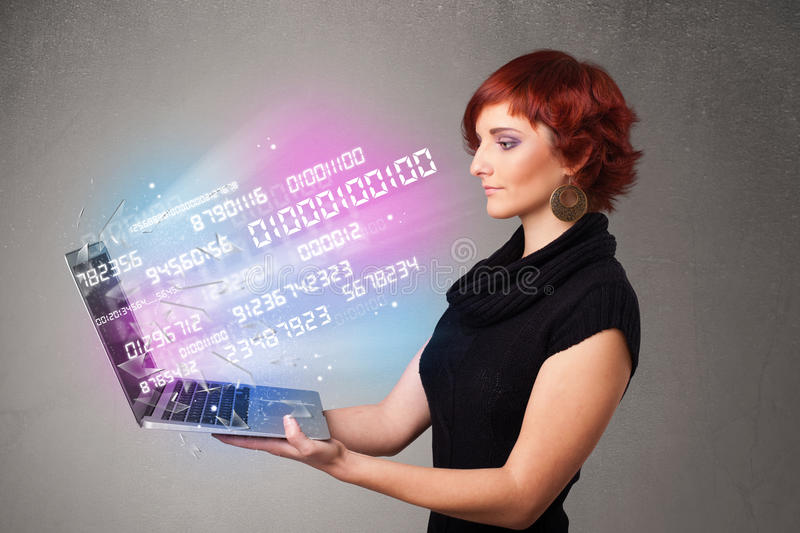 Casual woman holding laptop with exploding data and numers. Attractive casual woman holding laptop with exploding data and numers stock photography