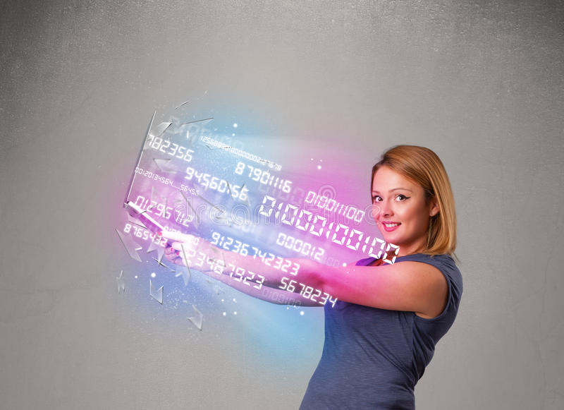 Casual woman holding laptop with exploding data and numers. Attractive casual woman holding laptop with exploding data and numers royalty free stock image