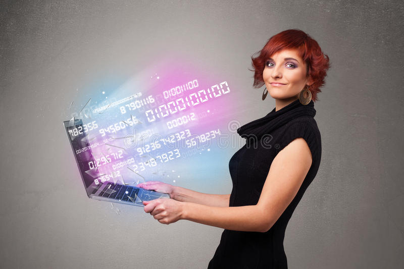 Casual woman holding laptop with exploding data and numers. Attractive casual woman holding laptop with exploding data and numers royalty free stock photo
