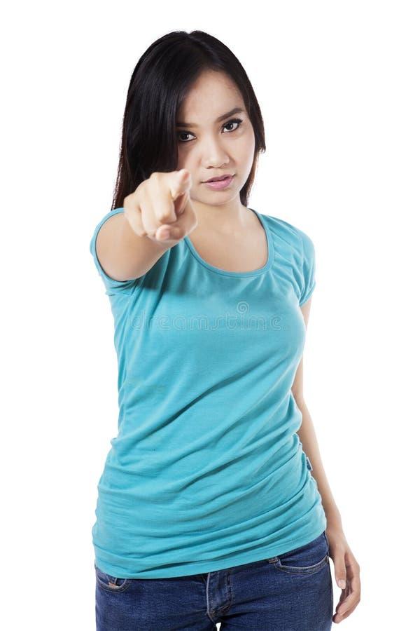 Casual woman pointing at camera royalty free stock image