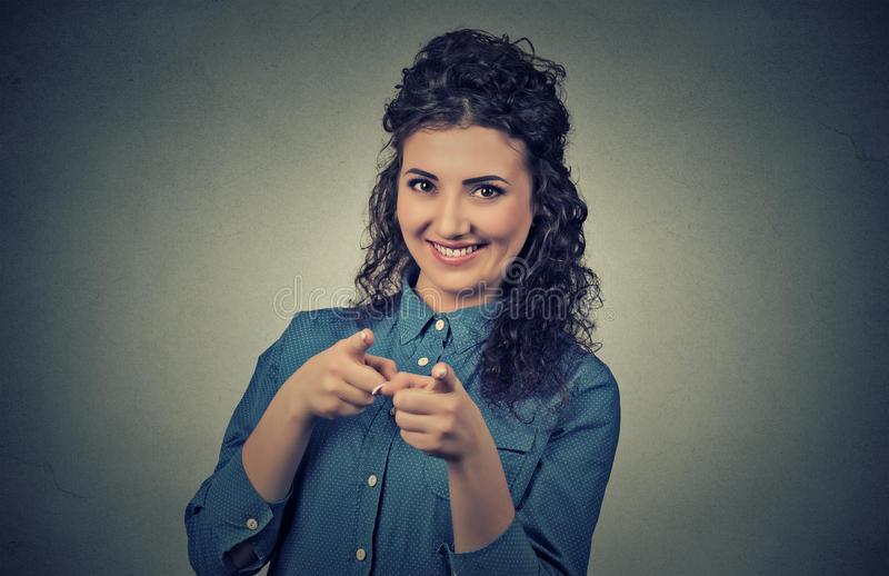 Casual woman pointing fingers at you camera gesture stock image