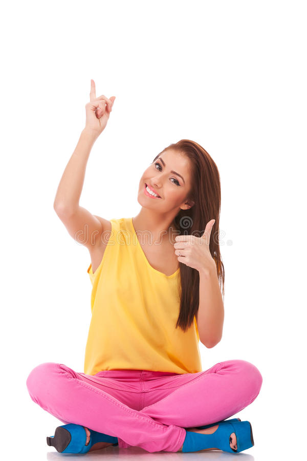Casual woman pointing up and make ok royalty free stock images