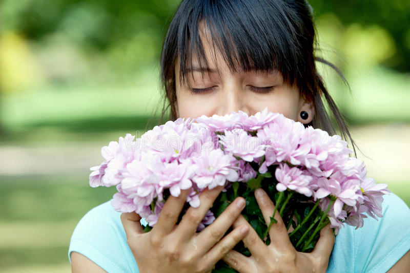 Download Casual Woman Smelling Flowers Stock Photo - Image: 12002220
