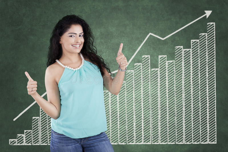 Casual woman with thumbs up and chart stock photo