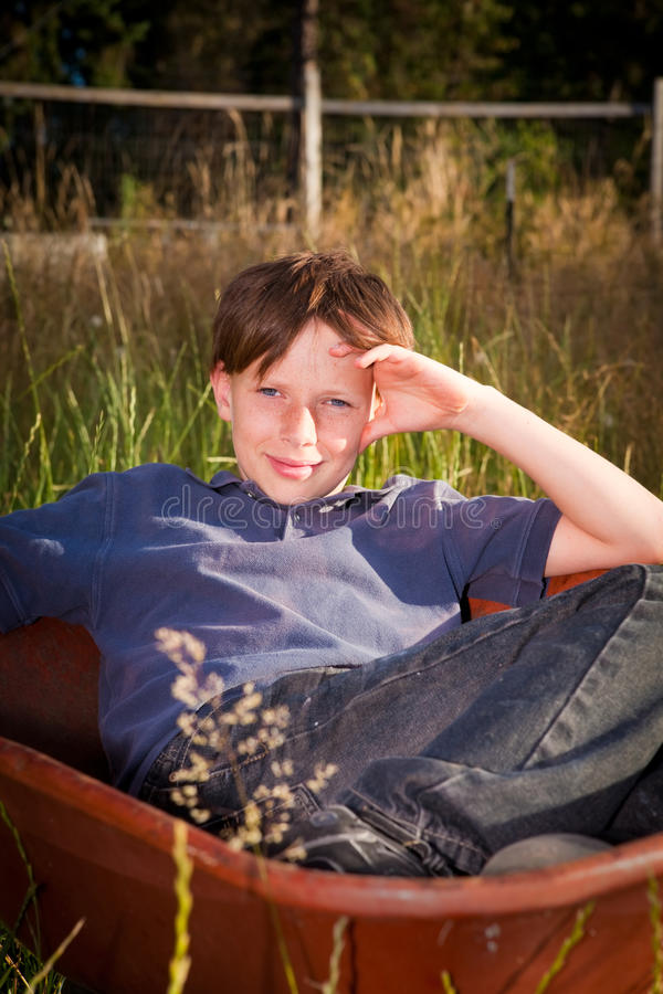 Download Casual Young Boy In A Wheelbarrow Royalty Free Stock Photos - Image: 32712128