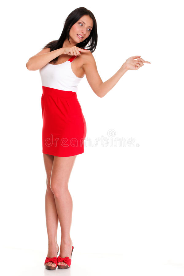 Casual young business woman looking, pointing royalty free stock photo