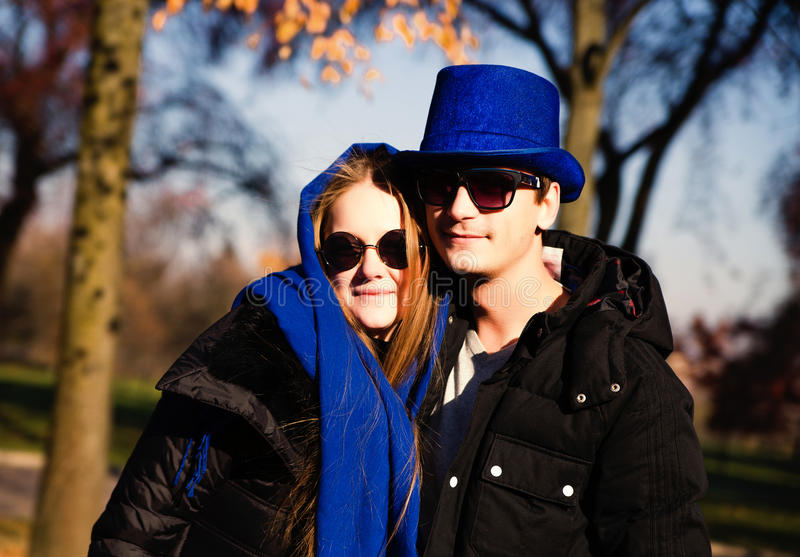 Casual young couple in a park stock photos