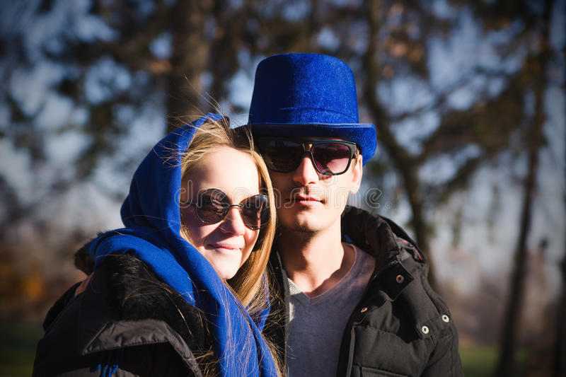 Casual young couple in a park royalty free stock image