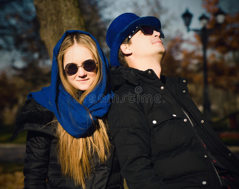Casual young couple in a park stock image