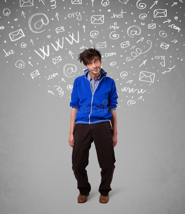 Casual young man with abstract white media icon doodles royalty free stock photography