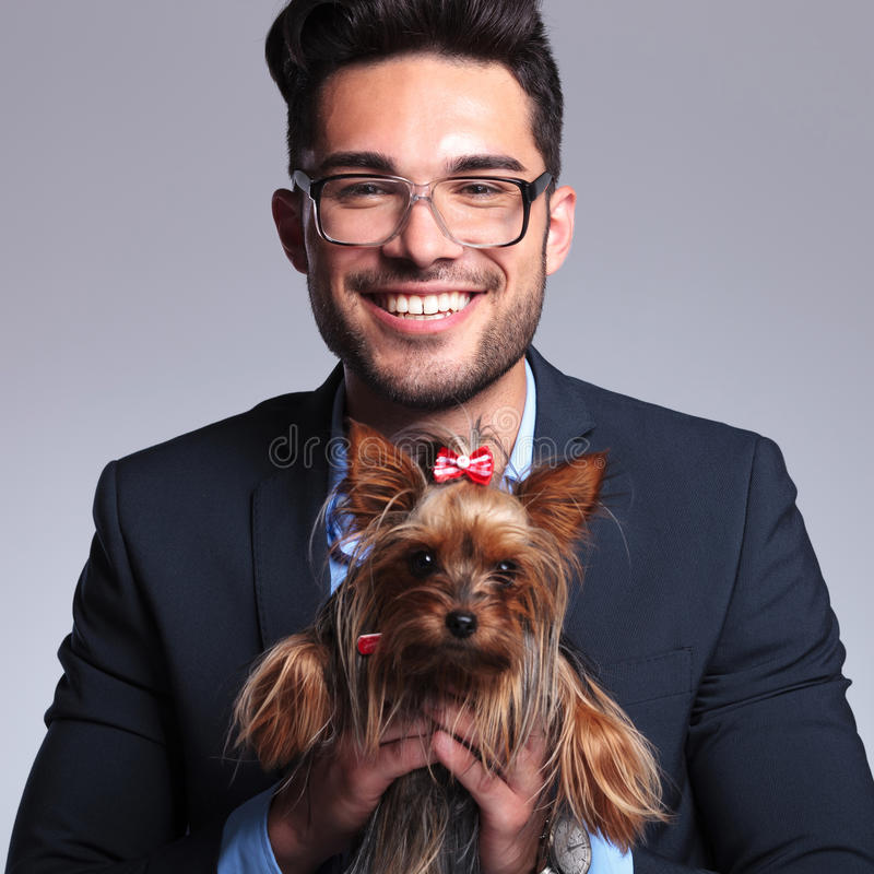Download Casual Young Man Holds Cute Puppy Stock Image - Image: 33178575