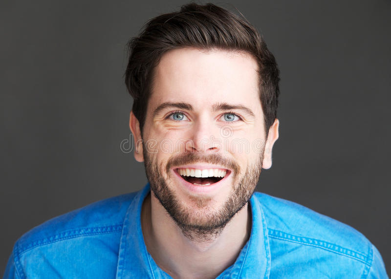 Download Casual Young Man Laughing On Gray Background Stock Photo - Image: 33838778