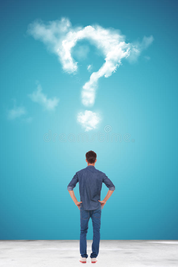 Download Casual Young Man Looking At A Big Question Mark Made Of Clouds Royalty Free Stock Photos - Image: 34027518