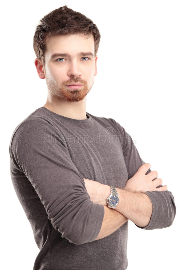 Download Casual Young Man Looking At Camera With Arms Crossed Royalty Free Stock Images - Image: 30048899