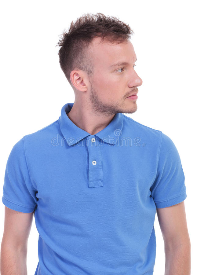 Casual young man looks to his side royalty free stock image