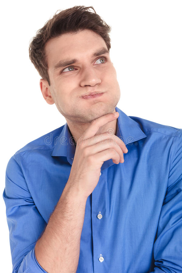 Casual young man making a funny face stock images
