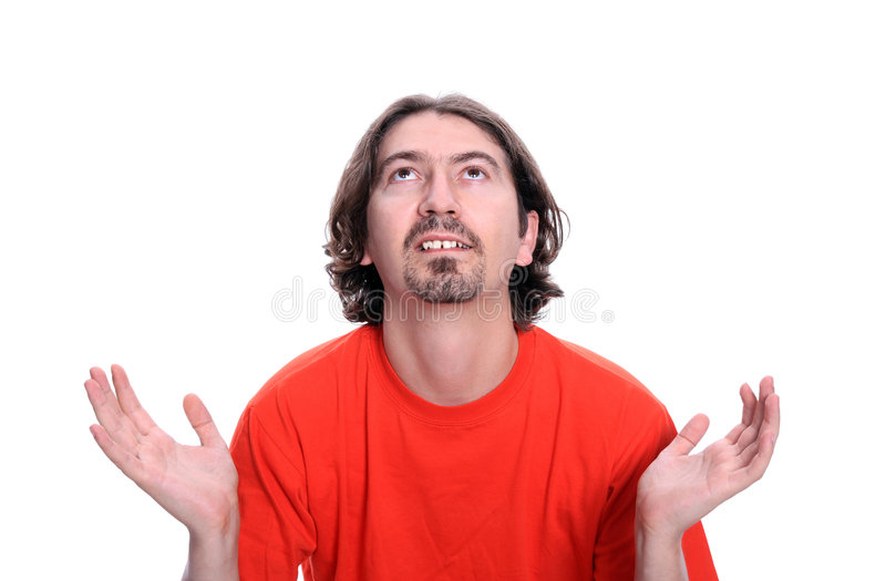 Casual young man praying royalty free stock images