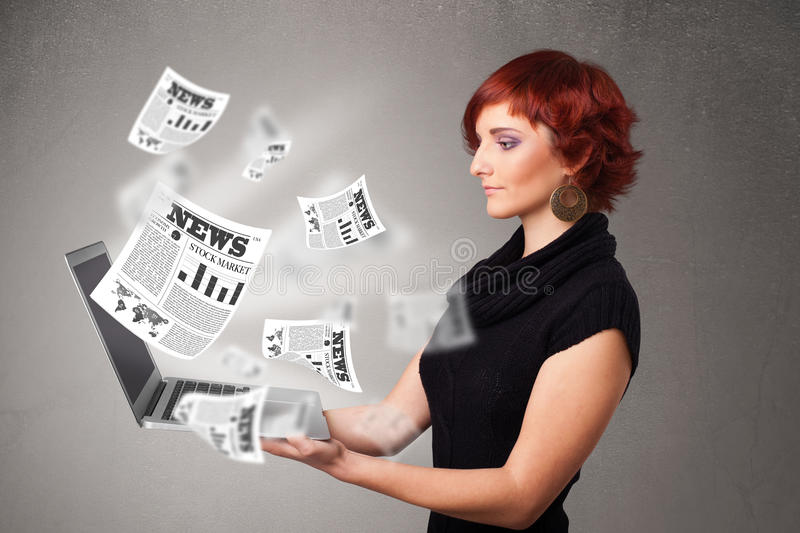 Casual young woman holdin notebook and reading the explosive news. Casual pretty young woman holdin notebook and reading the explosive news royalty free stock photography