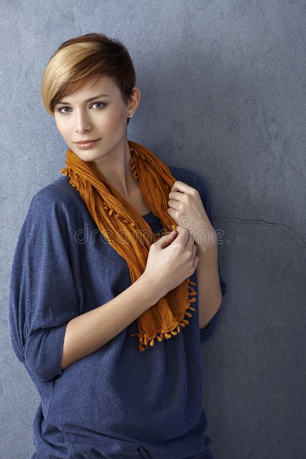 Casual young woman leaning to wall stock photos
