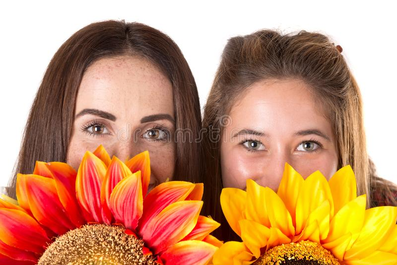 Casual young women with flowers royalty free stock photo