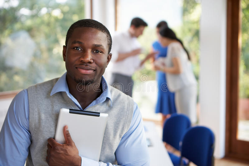 Casually Dressed Businessman Attending Meeting In Boardroom stock image