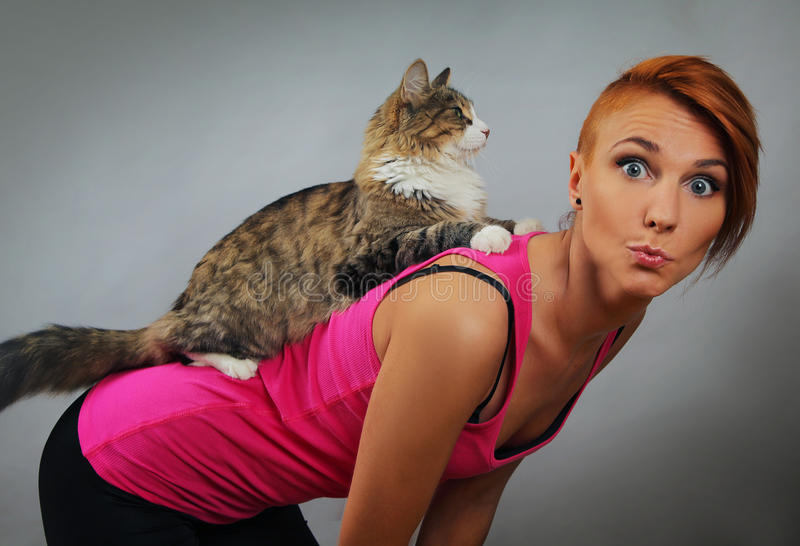 With cat. Funny young woman with cat royalty free stock image