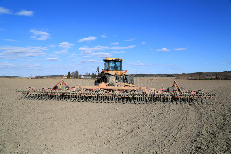 Cat Challenger Tractor and Potila Cultivator royalty free stock photography