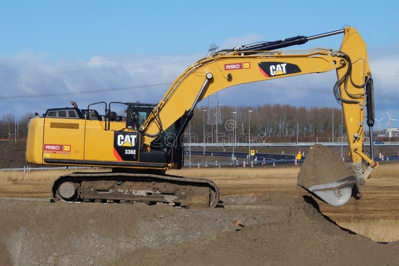 CAT 336e Hybrid Hydraulic Large Excavator - Caterpillar. Almere, Flevoland, The Netherlands - March 3, 2016: Caterpillar CAT 336e Hydraulic Crawler Excavator stock images